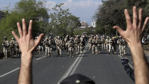 A demonstrator holds up his hands toward advancing soldiers during a protest in Santiago, Chile, on October 20.
