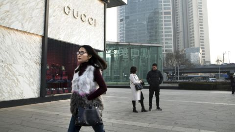 Pedestrians stand outside a Guccio Gucci SpA store in the Wangfujing shopping area of Beijing, China, on Saturday, Jan. 12, 2019. The luxury-goods industrys fate is closely linked to the perceived strength of demand from affluent Chinese consumers. Most analysts expect the economy to cool amid a trade spat with the U.S. Photographer: Giulia Marchi/Bloomberg via Getty Images