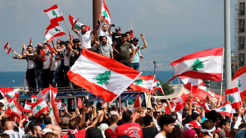 """Anti-government protesters chant slogans and wave their national flags at Martyr's Square, in downtown Beirut, Lebanon, Sunday, Oct. 20, 2019. Lebanon is bracing for what many expect to be the largest protests in the fourth day of anti-government demonstrations. Thousands of people of all ages were gathering in Beirut's central square Sunday waving Lebanese flags and chanting the, """"people want to bring down the regime."""" (AP Photo/Hussein Malla)"""