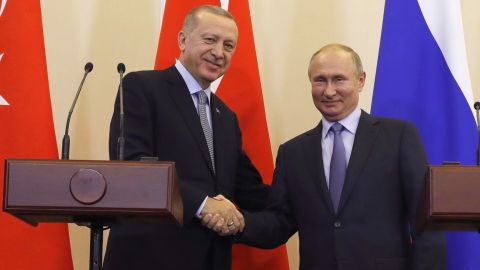Russian President Vladimir Putin, right, and Turkish President Recep Tayyip Erdogan shake hands after a joint news conference after their talks in the Bocharov Ruchei residence in the Black Sea resort of Sochi, Russia, Tuesday, Oct. 22, 2019. Erdogan says Turkey and Russia have reached a deal in which Syrian Kurdish fighters will move 30 kilometers (18 miles) away from a border area in northeast Syria within 150 hours. (Turkish Presidential Press Service/Pool Photo via AP)