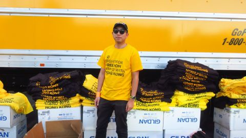 A free speech defender, who goes by the alias Sun, organized handouts of 13,000 T-shirts before the game between the Los Angeles Lakers and Los Angeles Clippers at the Staples Center on Tuesday.