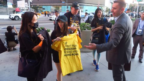 Fans entering the Staples Center arena to watch the opening night game grabbed T-shirts in yellow and black.