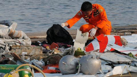 A member of Indonesian Search and Rescue Agency  inspects debris believed to be from Lion Air passenger jet that crashed off Java Island at Tanjung Priok Port in Jakarta, Indonesia Monday, Oct. 29, 2018.
