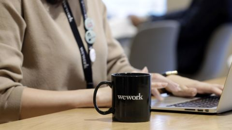 A branded mug sits on a table inside the WeWork Ocean Gate Minatomirai co-working office space, operated by The We Company, in Yokohama, Japan, on Friday, Oct. 11, 2019. WeWork formally withdrew the prospectus for an IPO this month, capping a botched fundraising effort that cost its top executive his job. The defeat places urgency on WeWork to find new sources of capital to keep its business running Photographer: Kiyoshi Ota/Bloomberg via Getty Images