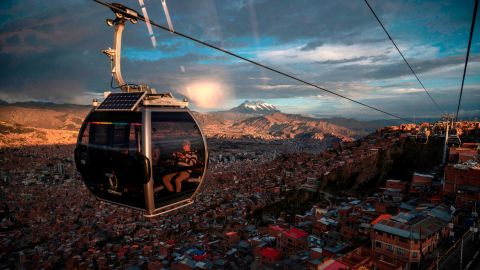 <strong>El Alto, Bolivia: </strong>A cable car in El Alto, Bolivia's second-largest city, offers views of the capital, La Paz, and Illimani Mountain in the distance. <br />