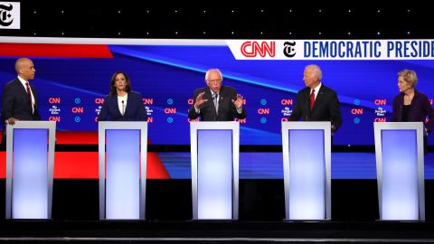 WESTERVILLE, OHIO - OCTOBER 15: Sen. Cory Booker (D-NJ), Sen. Kamala Harris (D-CA), Sen. Bernie Sanders (I-VT), former Vice President Joe Biden, and Sen. Elizabeth Warren (D-MA)  interact during the Democratic Presidential Debate at Otterbein University on October 15, 2019 in Westerville, Ohio. A record 12 presidential hopefuls are participating in the debate hosted by CNN and The New York Times. (Photo by Win McNamee/Getty Images)