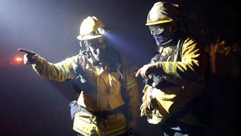 Two firefighters discuss a plan while battling the wildfire in Geyserville.