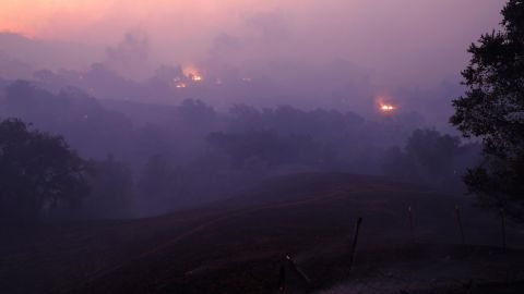 The sun rises above a smoke-filled valley in Geyserville on October 24.