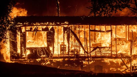 Flames consume a home in Jimtown, California, on October 24.
