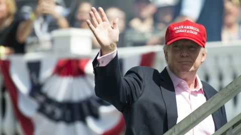 US President Donald Trump waves to wellwishers as he arrives at the 72nd US Women's Open Golf Championship at Trump National Golf Course in Bedminster, New Jersey, July 16, 2017. / AFP PHOTO / SAUL LOEB        (Photo credit should read SAUL LOEB/AFP/Getty Images)