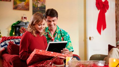 """Julianna Guill and Corey Sevier star in """"Grounded for Christmas"""" premiering December 8 on Lifetime."""