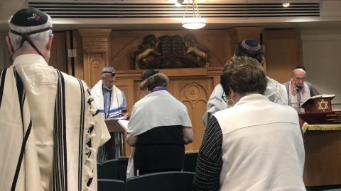 Joe Charny, right, participates in the morning service ahead of the anniversary of the massacre at the Tree of Life synagogue.