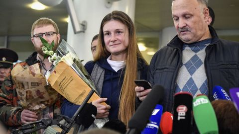 TOPSHOT - Maria Butina (C), who served nine months in a US jail for acting as a Russian government agent talks to the press as she arrives at Moscow's Sheremetyevo airport on October 26, 2019, a day after her release from prison. - She was arrested in July 2018 on allegations of engaging in espionage. In December, Butina entered a plea deal on a charge that she acted as an illegal, unregistered foreign agent, and was sentenced to 18 months in prison, half of which was credited as already served. (Photo by Alexander NEMENOV / AFP) (Photo by ALEXANDER NEMENOV/AFP via Getty Images)