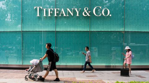 Pedestrians walk past an American luxury jewellery and speciality retailer Tiffany & Co. store in Shanghai.