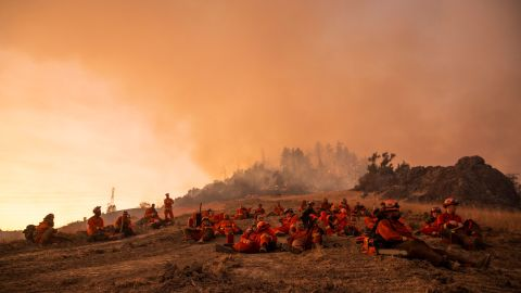 A crew of inmate firefighters takes a break during firefighting operations to battle the Kincade Fire in Healdsburg, California on October 26, 2019.