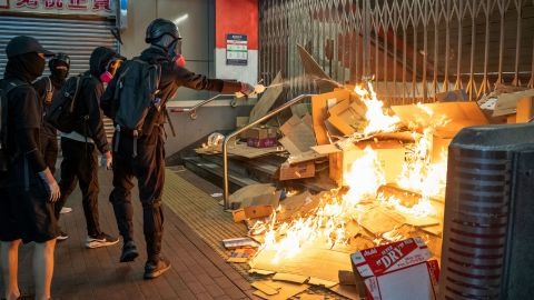 Protesters start a fire in front of the MTR station during demonstration on October 27.