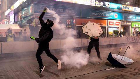 A protester throws a tear gas canister on October 27 in Hong Kong.