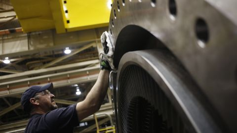 A worker cleans a part of a gas turbine on the assembly line at the General Electric Co. (GE) energy plant in Greenville, South Carolina, U.S., on Tuesday, Jan. 10, 2017. General Electric Co. is scheduled to release earnings figures on January 20. Photographer: Luke Sharrett/Bloomberg via Getty Images