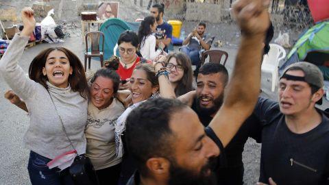 Anti-government protesters in Lebanon celebrate after Saad Hariri announced his resignation.