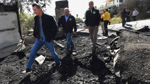 From left, California Governor Gavin Newsom, L.A. City Councilman Mike Bonin, and L.A. City Mayor Eric Garcetti tour a burned home along Tigertail Road in Brentwood, Calif., Tuesday Oct. 29, 2019. (Wally Skalij/Los Angeles Times via AP, Pool)
