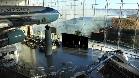 An Air Force One from Ronald Reagan's presidency sits on display as the Easy Fire burns near Reagan's presidential library on October 30.