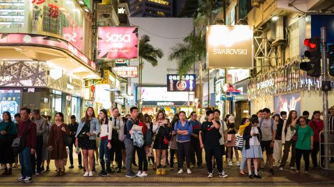 Pedestrians prepare to cross a road in the popular shopping district of Causeway Bay in Hong Kong on October 30, 2019, a day before the citys third-quarter gross domestic product (GDP) figures are released. (Photo by Anthony WALLACE / AFP) (Photo by ANTHONY WALLACE/AFP via Getty Images)
