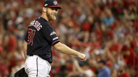 WASHINGTON, DC - OCTOBER 14: Stephen Strasburg #37 of the Washington Nationals smiles as he walks back to the dug out in the fifth inning of game three of the National League Championship Series against the St. Louis Cardinals at Nationals Park on October 14, 2019 in Washington, DC. (Photo by Patrick Smith/Getty Images)