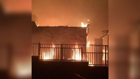Julien Cooper filmed his neighbor's house in flames as the Hillside Fire moved into his neighborhood on Thursday.