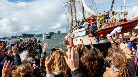 The group of climate activists are seen saying goodbye from the boat just departing where they are going to be sailing to COP25 in Chile. Amsterdam, October 2nd, 2019.