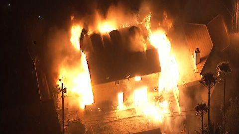 A fire consumes a home Thursday in northern San Bernardino.