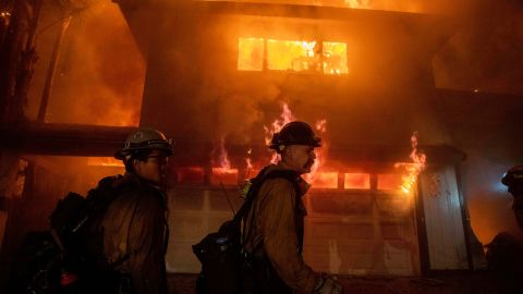 Firefighters work to prevent a blaze from spreading to other homes in San Bernardino.