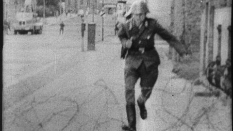 East German border guard Conrad Schumann's August 1961 escape over what was then a simple barbed wire barrier became one of the most memorable images of the Cold War era.