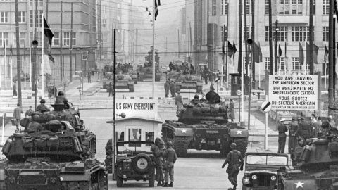 """Soviet and American tanks face off at the border crossing known as """"Checkpoint Charlie,"""" in October 1961."""