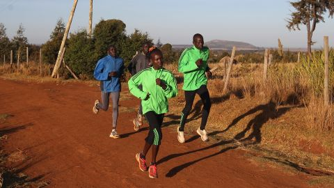Mary Keitany (front left) trains her husband and coach Charles Koech (front right) in Iten, Kenya.