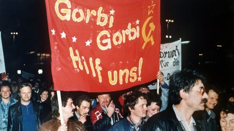 """Protesters carry a banner reading """"Gorbi Gorbi help us!"""" during a visit to East Germany by Mikhail Gorbachev -- then leader of the Soviet Union -- in October 1989."""