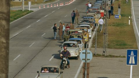 A line of East Germany's famous Trabant cars heads West along a highway near Leipzig, following the fall of the Wall.