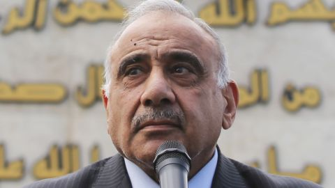 Iraq's Prime Minister Adel Abdel Mahdi speaks during a symbolic funeral ceremony in Baghdad on October 23, 2019 for Major General Ali al-Lami, a commander of the Iraqi Federal Police's Fourth Division, who was killed the previous day in Samarra in the province of Salahuddin, north of the Iraqi capital. - The police commander was killed in an ambush on October 22 which Iraqi security forces blamed on dormant cells of the Islamic State (IS) group. (Photo by AHMAD AL-RUBAYE / AFP) (Photo by AHMAD AL-RUBAYE/AFP via Getty Images)