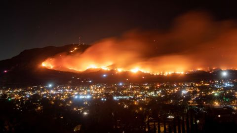 A long-exposure photo shows the Maria Fire as it races across a hillside in Santa Paula, California, on November 1.