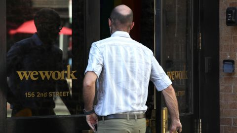 SAN FRANCISCO, CALIFORNIA - OCTOBER 07: A man enters a WeWork office on October 07, 2019 in San Francisco, California. Days after withdrawing its registration for an initial public offering, WeWork also warned employees that the company could be set to lay off nearly 2,000 people, about 16 percent of its workforce. (Photo by Justin Sullivan/Getty Images)