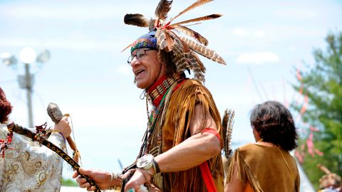 Performers make their way around the dance circle during the Spring Planting Moon Pow Wow in Marshfield, Massachusetts, in May 2019.