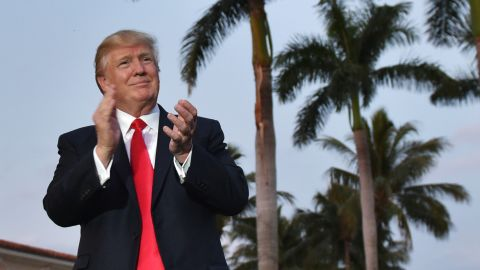 US President Donald Trump watches the Palm Beach Central High School marching band which greeted him as he arrived to watch the Super Bowl at Trump International Golf Club Palm Beach in West Palm Beach, Florida on February 5, 2017. / AFP / MANDEL NGAN        (Photo credit should read MANDEL NGAN/AFP via Getty Images)