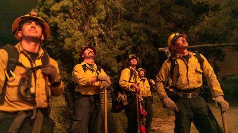 Firefighters watch the progress of a backfire near Somis.