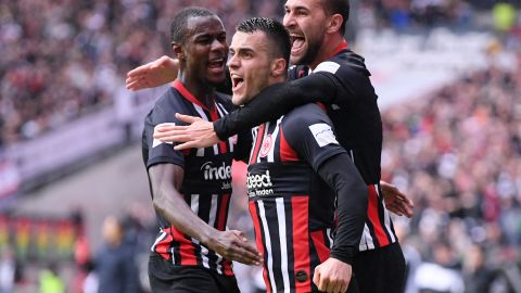 Filip Kostic of Eintracht Frankfurt celebrates with teammates after scoring his team's first goal in the 5-1 rout of Bayern Munich.