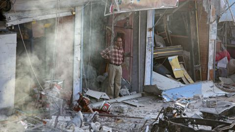 A man inspects the site of the car bomb explosion in Tal Abyad.