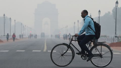 A man rides a cycle past the India Gate on a smoggy morning in New Delhi, India, October 28, 2019 REUTERS/Adnan Abidi