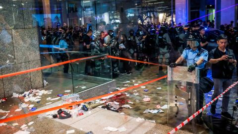 Blood and debris are seen on the ground at the entrance of a shopping mall as riot police secure the scene after a bloody knife fight broke out in Hong Kong on November 3, 2019. - A bloody knife fight in Hong Kong left six people wounded on November 3 evening, including a local pro-democracy politician who had his ear bitten off, capping another chaotic day of political unrest in the city. (Photo by VIVEK PRAKASH / AFP) (Photo by VIVEK PRAKASH/AFP via Getty Images)