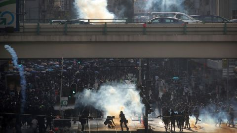 Thousands of black-clad masked protesters streamed into Hong Kong's central shopping district for another rally on November 2.