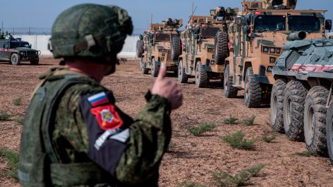 A Turkish and Russian patrol is seen near the town of Darbasiyah, Syria, on Friday, November 1. Turkey and Russia launched patrols in northeastern Syria under a deal that halted the Turkish offensive against Syrian Kurdish fighters.