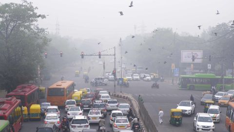 """In this Sunday, Nov. 3, 2019, photo, vehicles wait at a crossing amidst morning smog in New Delhi, India. Authorities in New Delhi are restricting the use of private vehicles on the roads under an """"odd-even"""" scheme based on license plates to control vehicular pollution as the national capital continues to gasp under toxic smog. (AP Photo/Manish Swarup)"""