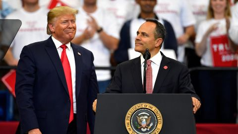 Kentucky Gov. Matt Bevin, right, looks out at the crowd as President Donald Trump watches during a campaign rally in Lexington, Kentucky, Monday, November 4.